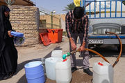 امام جمعه خرمشهر درحال جوشکاری لوله انتقال آب+عکس