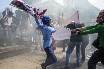 مخالفان افراط گرایی در آمریکا به خیابان ها ریختند